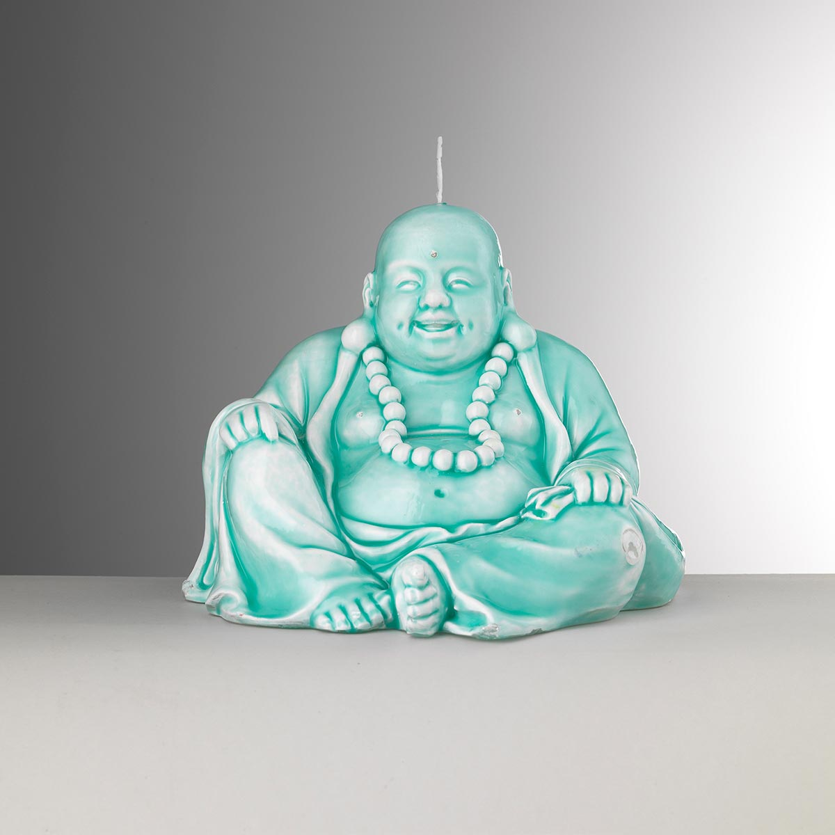 Bougie turquoise<br>H: 15cm, W: 18cm<br>Buddha